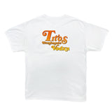 Back of white short-sleeved t-shirt with orange to yellow fade Tito's Handmade Vodka mark