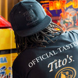 Man wearing Tito's Solid Black Snapback