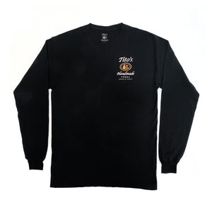 Front of black long-sleeved t-shirt with Tito's Handmade Vodka logo on left breast