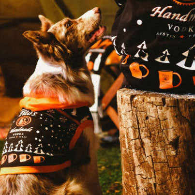 Dog wearing Tito's Handmade Vodka hooded sweatshirt for dogs
