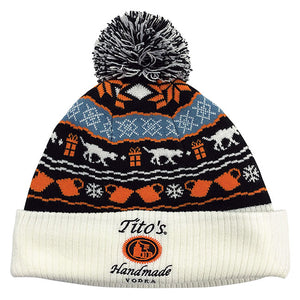 Knit beanie with pom-pom, Tito's Handmade Vodka logo, and holiday designs of copper mugs, snowflakes, and dogs