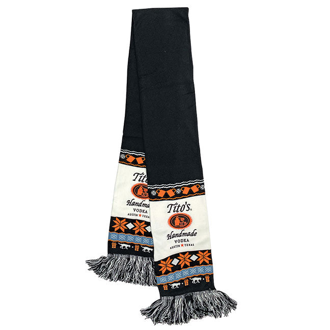Knit scarf with embroidered Tito's Handmade Vodka logo and holiday designs of copper mugs, snowflakes, presents, and dogs