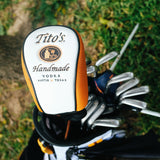Tito's golf head cover on a club in a golf bag