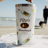 White Corkcicle tumbler with Tito's Handmade Vodka logo, cocktails and Tito's bottle illustrations at the beach