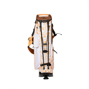 Back of orange and white golf bag with Tito's cocktail illustrations