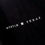 Black long sleeve with Austin, Texas text on sleeve