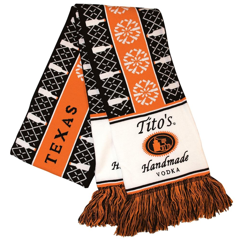 Orange, black, and white knit scarf with holiday designs and embroidered with Tito's Handmade Vodka logos