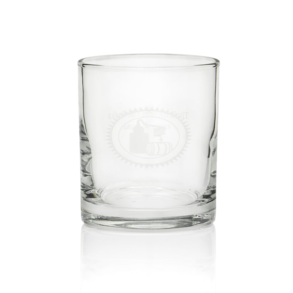 Front of rocks glass with Tito's distillery graphic