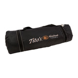 Rolled up water-resistant picnic blanket with Tito's Handmade Vodka logo