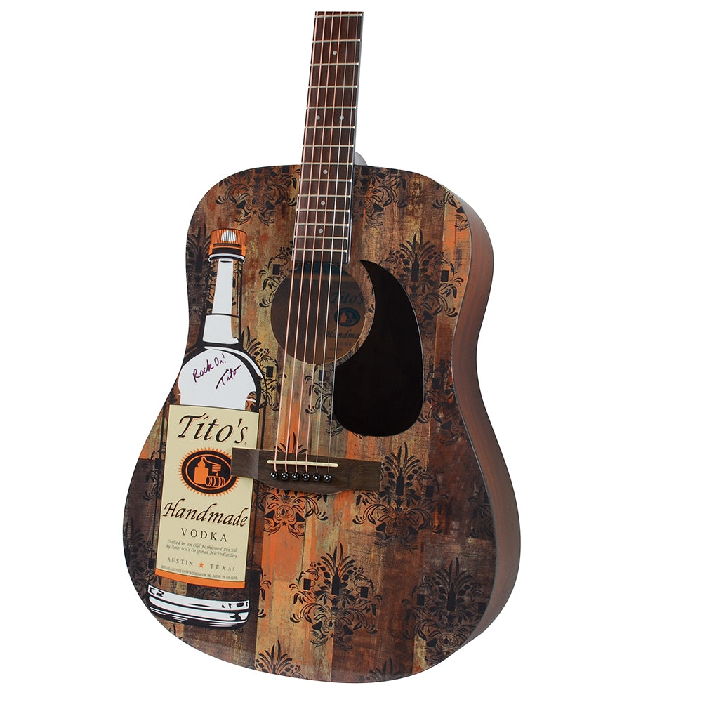 Acoustic guitar signed by Tito Beveridge, Tito's bottle graphic on front, mahogany color, close-up