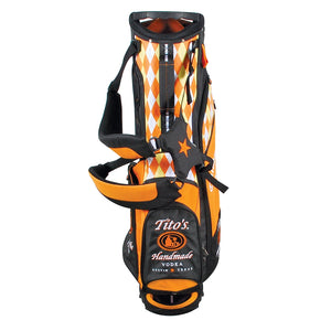 Orange and black golf bag with Tito's Vodka logo