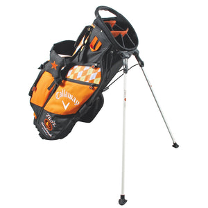Side view of black and orange stand golf bag with Tito's Vodka logo