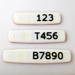 White Braille and Tactile Sign with Black Tactile Numbers and Characters for Australian Taxi and Ride Sharing Fleets
