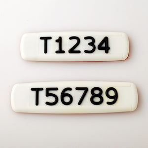 White Tactile Sign with Black Tactile Numbers and Characters for Australian Taxi and Ride Sharing Fleets