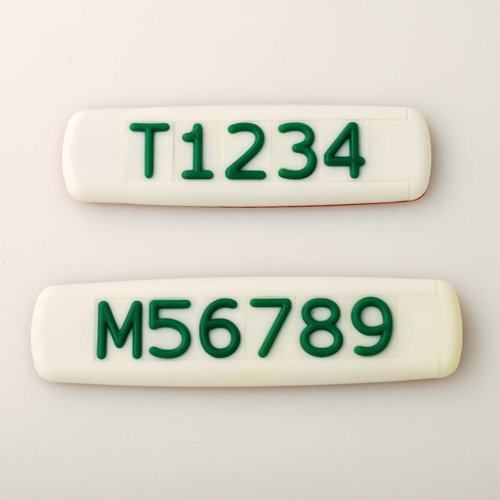 White Tactile Sign with Green Tactile Numbers and Characters for Australian Taxi and Ride Sharing Fleets