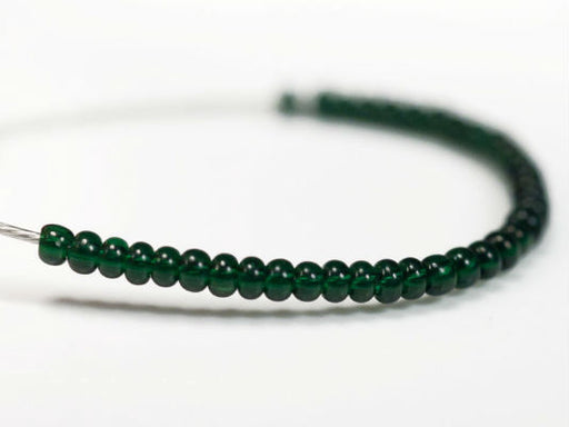 20 g 13/0 Seed Beads Preciosa Ornela, Dark Green Transparent, Czech Glass