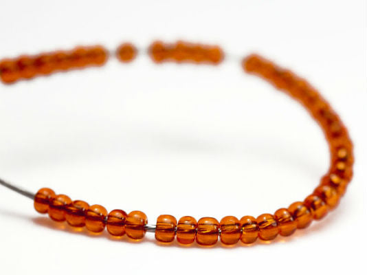 10 g 13/0 1-Cut Seed Beads Charlotte Preciosa Ornela, Orange Transparent, Czech Glass