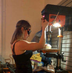 learning to work a drill press to upcycle fine china