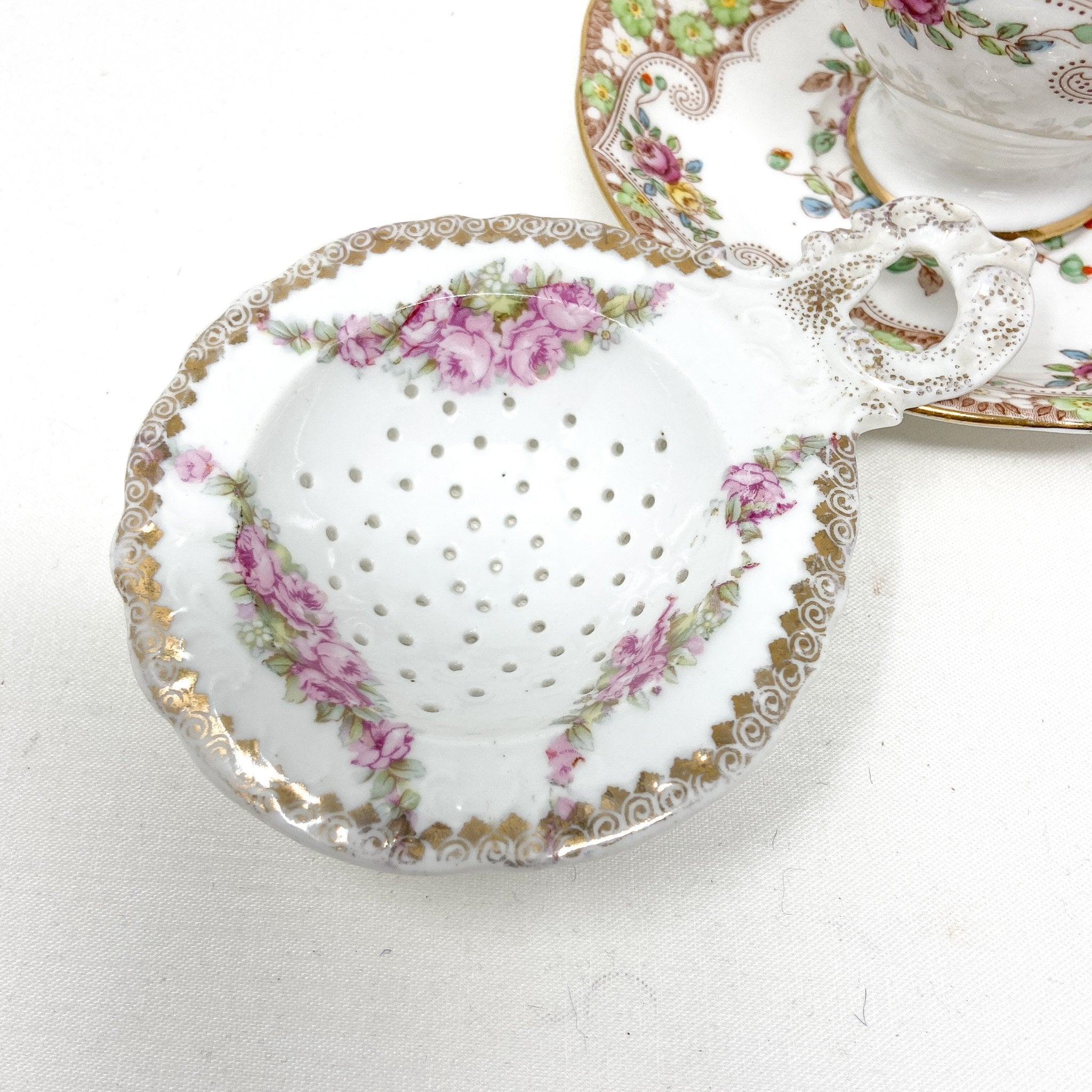 Royal Standard Rosemary | Teacup, Saucer & Strainer | The Brooklyn Teacup - close up of only the strainer with pink roses and gold swirls