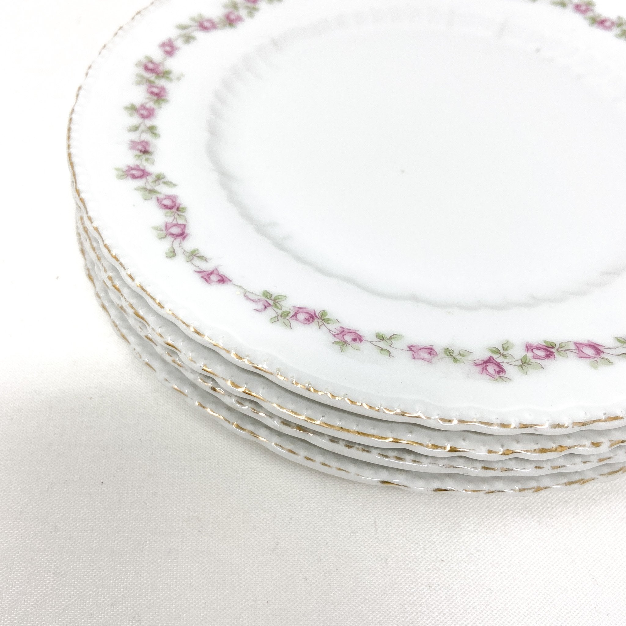 gilding faded on vintage china plates with rose pattern wreath - Victoria Austria - beautiful elegant white china