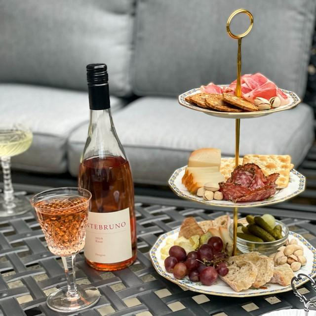 waterford crystal white wine glass with rose - outdoor cocktails and cheese, cracker charcuterie tower