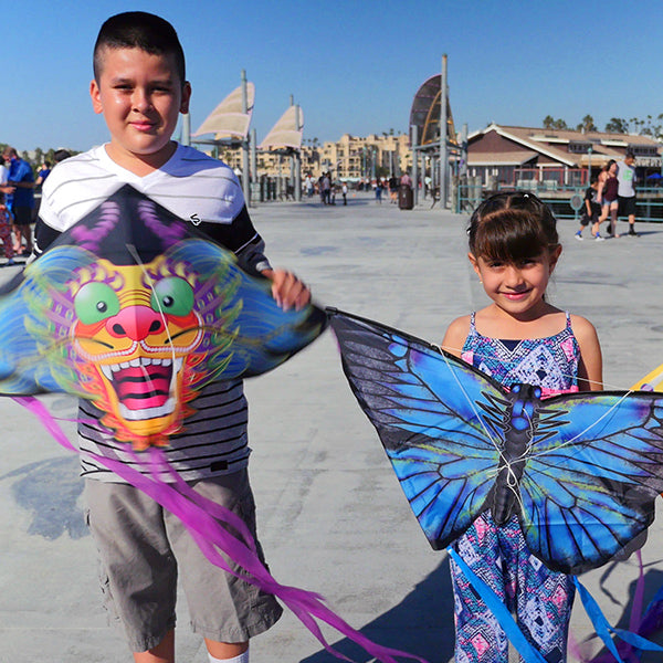 Brother and sister holding their X Kites kites