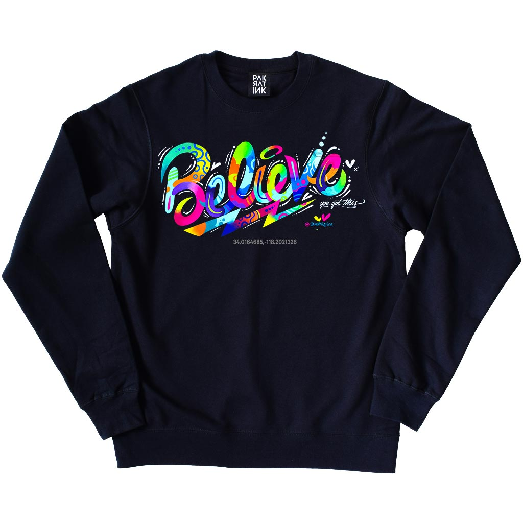 "PakRat Ink Unisex Crewneck Sweatshirt ""Believe"" by Jason Naylor"