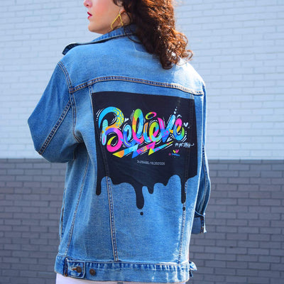 "PakRat Ink Unisex Denim Jacket ""Believe"" by Jason Naylor Close Up"