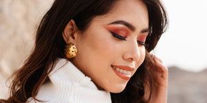 "Arka "" the beholder of the universe ,tht binds together one and all, spreading it's warmth n blaze piercing through the mighty himalayas This dome shape earring symbolises the majestic sun which depicts inner radiance."