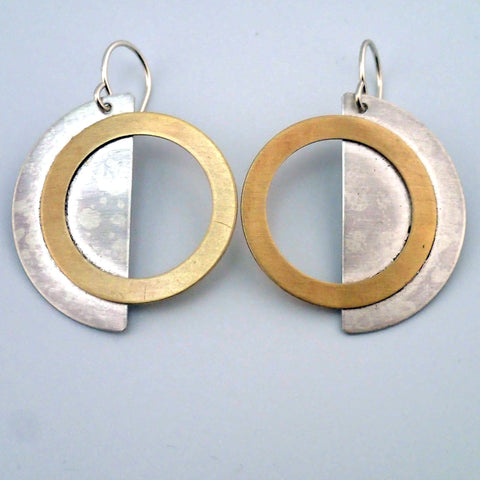 Eclipse earrings in silver and brass