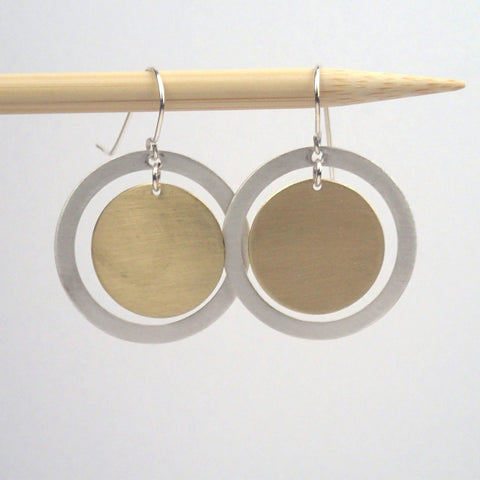 "Silver and Brass ""saturn"" circle earrings"