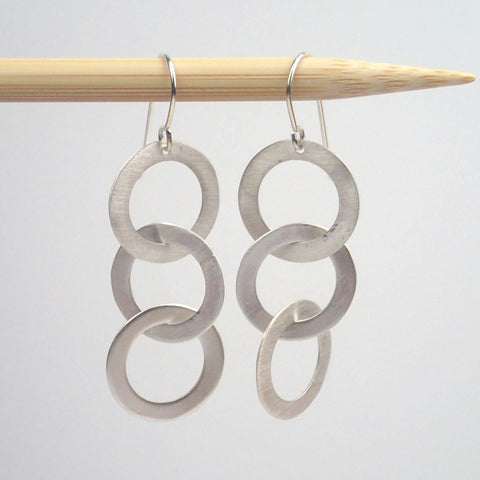 small silver Triplet earrings