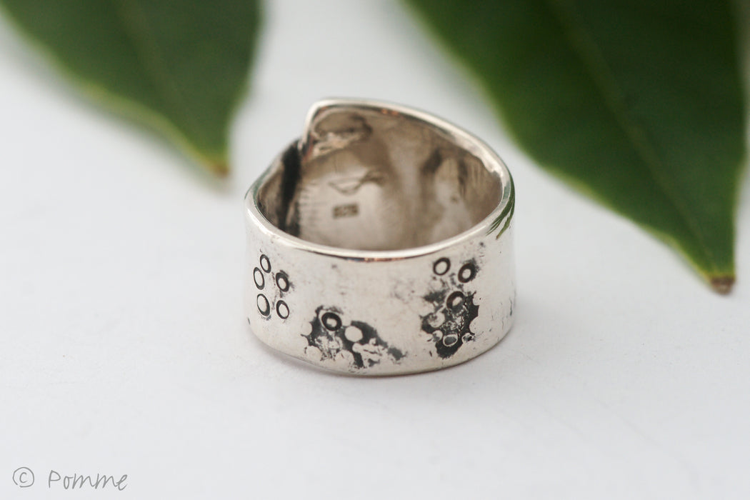 Silver wide band ring with botanical imrpessions