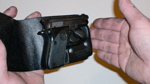 Wallet style top covered back pocket holster for licensed concealed weapon carry Beretta Bobcat 21A