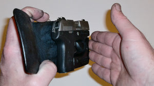 Wallet style top covered back pocket holster for licensed concealed weapon carry of Beretta Pico
