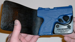 Wallet style top covered back pocket holster for licensed concealed weapon carry of Boberg XR9S