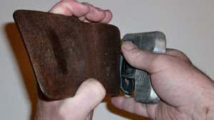 Wallet style top covered back pocket holster for licensed concealed weapon carry of Double Tap