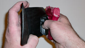 Wallet style top covered back pocket holster for licensed concealed weapon carry of Diamondback DB9