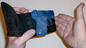 Wallet style top covered back pocket holster for licensed concealed weapon carry of Glock 26 27 33