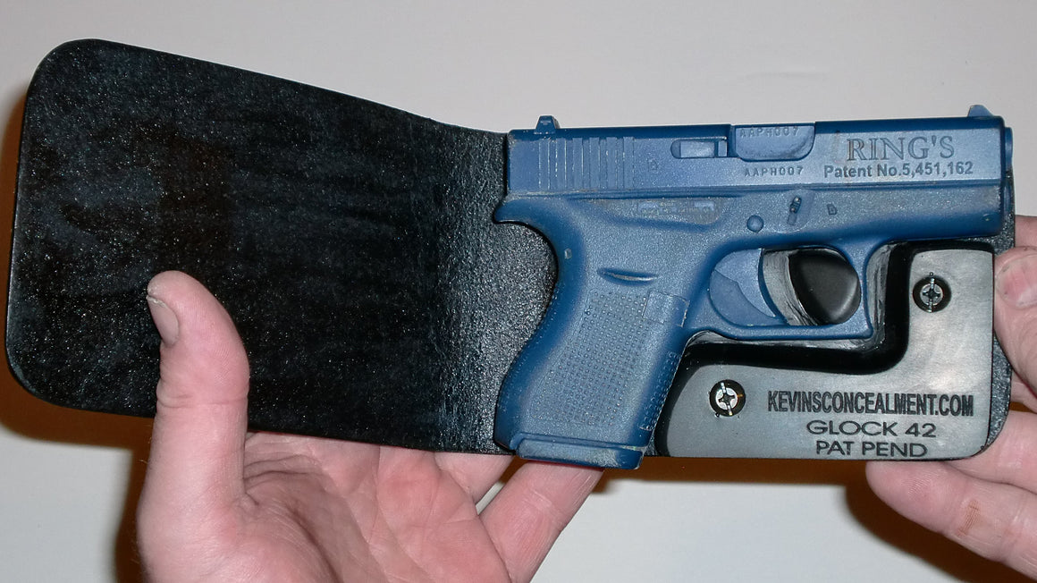 Wallet style top covered back pocket holster for licensed concealed weapon carry of Glock 42