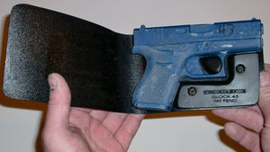 Wallet style top covered back pocket holster for licensed concealed weapon carry of Glock 43