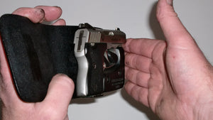 Wallet style top covered back pocket holster for licensed concealed weapon carry of NAA Guardian 380
