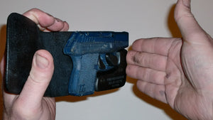 Wallet style top covered back pocket holster for licensed concealed weapon carry of Kel-Tec P3AT