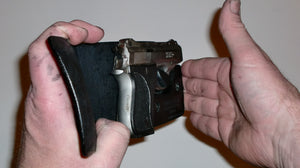 Wallet style top covered back pocket holster for licensed concealed weapon carry of Phoenix HP22