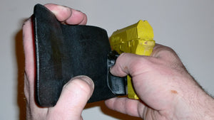 Wallet style top covered back pocket holster for licensed concealed weapon carry of Remington RM380
