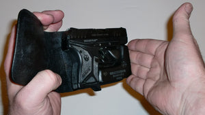 Wallet style top covered back pocket holster for licensed concealed weapon carry of Ruger LCPII