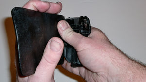 Wallet style top covered back pocket holster for licensed concealed weapon carry of Ruger LCP