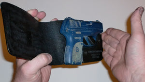 Wallet style top covered back pocket holster for licensed concealed weapon carry of Ruger LC9