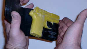 Wallet style top covered back pocket holster for licensed concealed weapon carry of Springfield 911