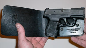 Wallet style top covered back pocket holster for licensed concealed weapon carry of Sig Sauer P365